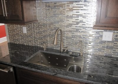 Great Contemporary Sink with Different Levels and Sink Areas Featuring a Touch Faucet