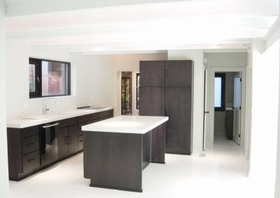 Award Winning Contemporary Kitchen with Clean Lines, Black Maple Cabinetry, Epoxy Concrete Floors and Quartz Countertops