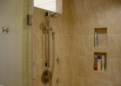 Master shower with handheld shower and body sprays