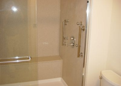 Acrylic shower pan, cultured granite walls and bench seat, custom plumbing set up with decorative gr