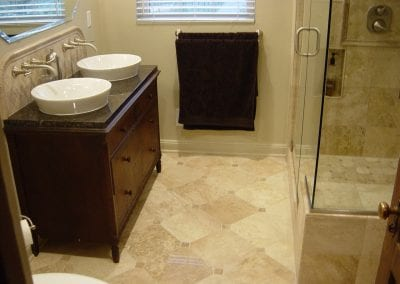 Bexley bathroom remodel. Antique furniture piece used as vessel stand in master bath.