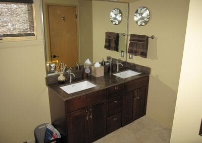 Cultured granite tops with under mount sinks. Walk in shower with matching cultured granite