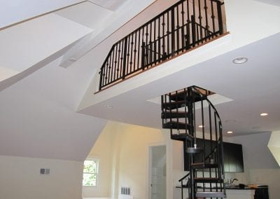 Finished loft area. Spiral staircase leading up to Loft area within the loft. Rod iron railing overl