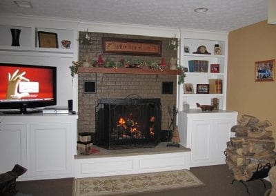 Custom built ins around fireplace, incorporating trim around hearth and new limestone hearth top.