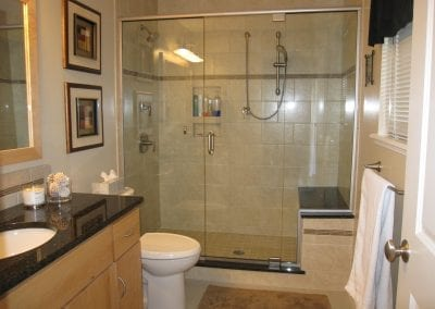 Master bath remodel. Custom shower with granite bench and two shower heads.