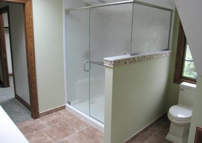 "Easy to maintain cultured granite shower panels. 3/8"" 'broken glass' shower enclosure"