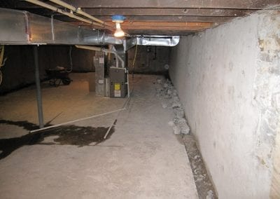 Removal of concrete to install weep system in basement to correct water problem.
