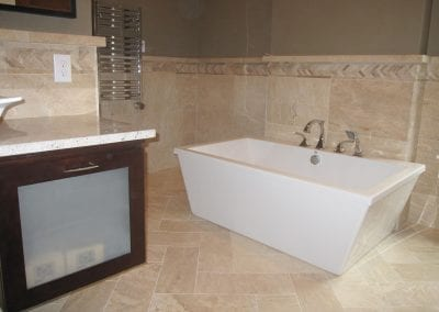 free standing contemporary tub, wainscoting tile