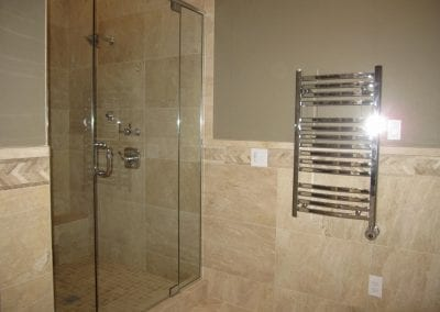 wall hung towel warmer and custom shower door enclosure.