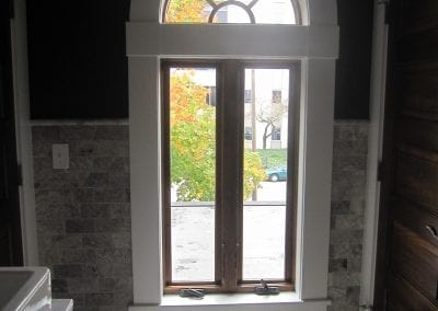 Let the light shine in!! This awesome arched window with white painted trim is only one of the eleme