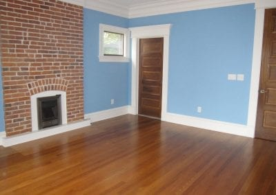 Spacious large spare bedroom. Kept the original brick and hardwood floors, while all the other eleme