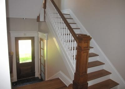 The homeowner decided to keep this original piece of the home. All of the newel posts, balusters and