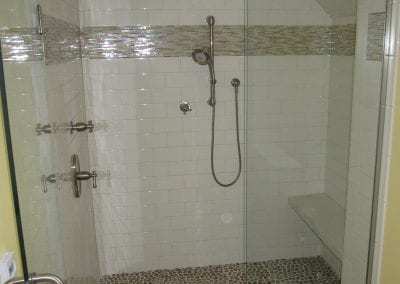 Large wall in shower with seat and handheld