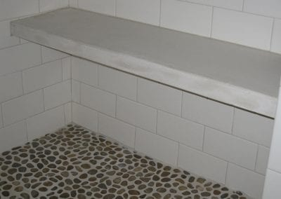 Floating concrete bench seat in shower