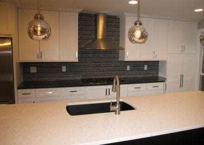 Quartz Island with Composite Sink and Granite Top with Cooktop