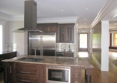 Built-in Microwave, Gas Stove Top Featuring Pot Filler on the Island