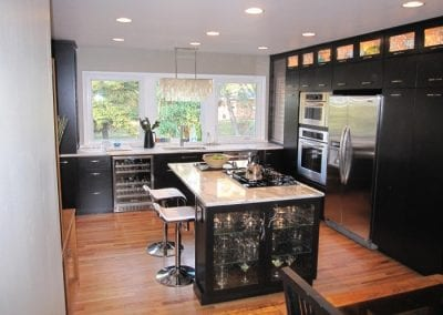 Great Use of Cabinet Lighting and Glass Cabinet Doors